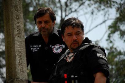 O Delegado Osvaldo Nico Gonçalves e o investigador Rodrigo Fukuoka Pessoal do GARRA.