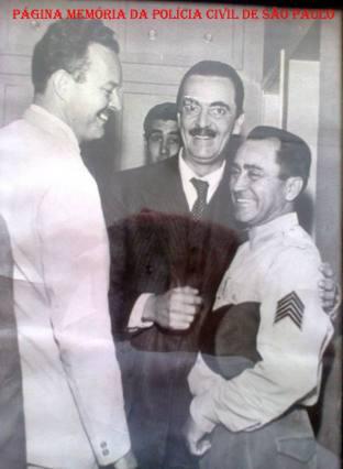 Delegado de Polícia Titular do Município de Olímpia, na década de 60, José Martins Schimmelpfeng Filho,à esquerda, ao centro o então Governador de São Paulo Jânio da Silva Quadros. (acervo do filho, o Delegado José Maurício Macedo Schimmelpfeng).